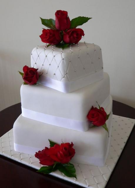 3 tier white wedding cake with fresh red roses jpg 1 comment. Black Bedroom Furniture Sets. Home Design Ideas