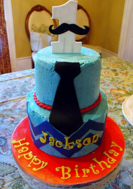 2 tier First Birthday Cake with black tie & large number 1 on top.JPG