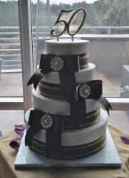 4 tier 50th Anniversary Cake multiple large bows.JPG