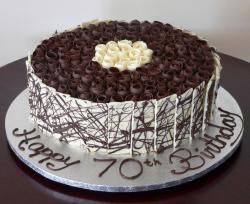 Round dark and white chocolate birthday cake.JPG