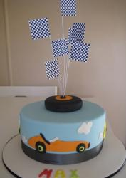 Car theme powder blue cake with checker flags.JPG