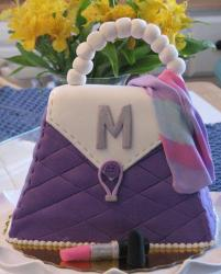Purple handbag with lipstick cake.JPG