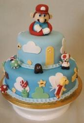 Two tier light blue Super Mario cake.JPG