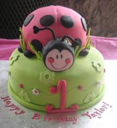 Green first birthday cake with ladybug on top.JPG