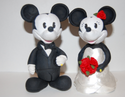 Mickey and Minnie Wedding Cake Topper with bride with red roses.PNG