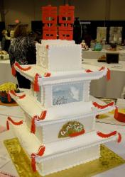Four tier Chinese temple wedding cake with Chinse wedding character writing as topper and the word Love written.JPG
