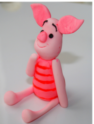 Piglet cake topper looking so cute.PNG