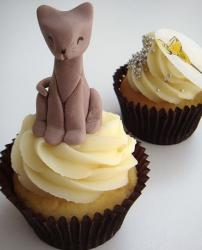 White chocolate cup cake with cat topper.JPG