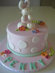 Light pink first birthday cake with bunny rabbit on top.JPG