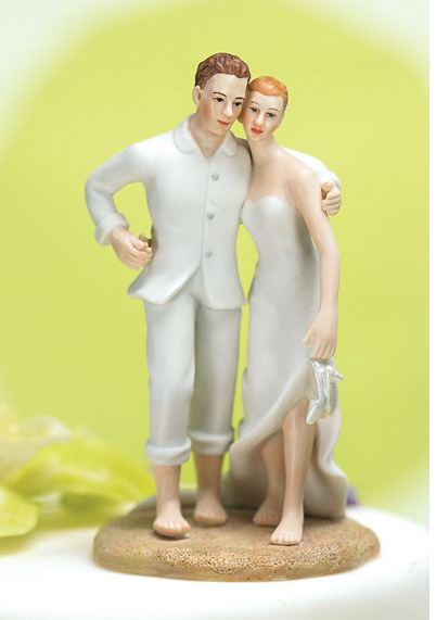 Beach wedding cake topper with bride and groom.PNG