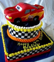 Disney two tier Cars theme cake with Lightning McQueen topper.JPG