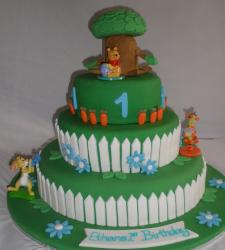 Three tier green Winnie the Pooh birthda cake for 1 year-old.JPG