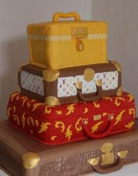 Four tier suit-case theme wedding cake.JPG