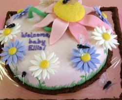 White garden flower theme baby shower cake.JPG