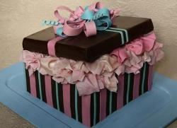 Brown and pink gift box cake with bow and tissue paper.JPG