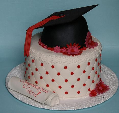 White graduation cake with black graduation hat topper and diploma.JPG