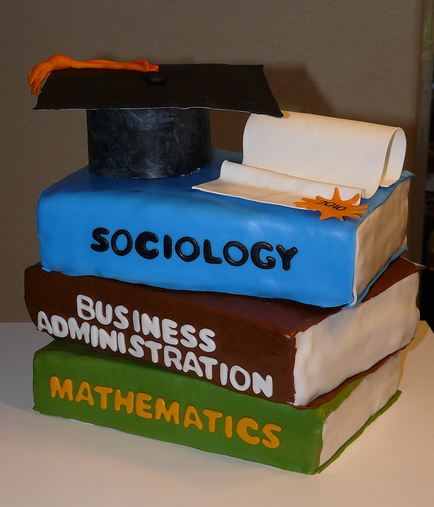 Books and graduation cap cake with diploma.JPG