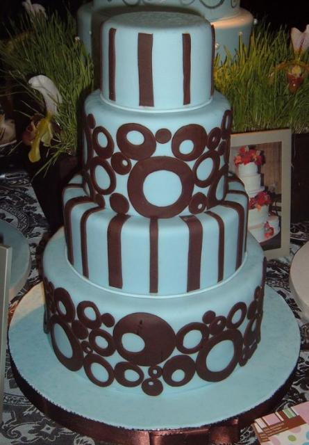 Four Tier Baby Blue Wedding Cake With Brown Circles And