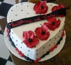 White heart-shaped bridal shower cake with red flowers.JPG
