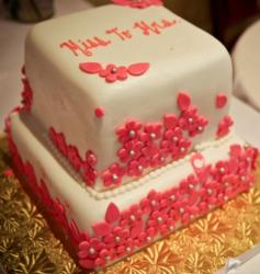 Two tier cubic white bridal shower cake with pink flower petal decor.JPG