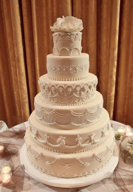 6 Tier Wedding Cake Light Tan Color White Flower On TopJPG