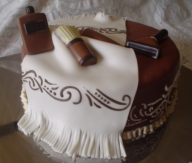 Artistic Father's day cake picture with very unique cake decor with white and dark chocolate.PNG