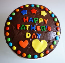 Chocolate round fathers day cake with colorful cake decors.PNG