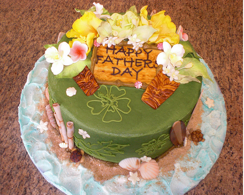 Fancy father's day cake with full of flowers and cake decor.PNG