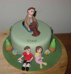 Father and children cake toppers on green fathers day cake image.PNG