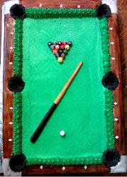 Pool table cake with pool cue and balls.JPG