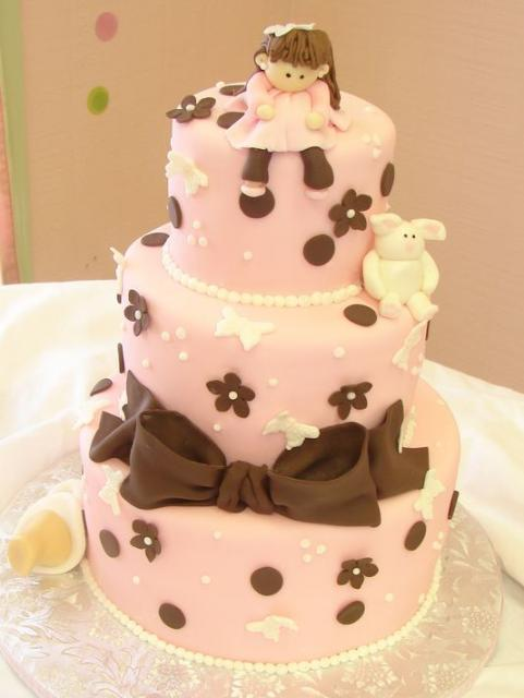 Three Tier Pink Baby Shower Cake With Pregnant Mom Topper