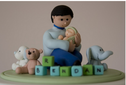 Fathers day cake topper with a father holding his baby.PNG