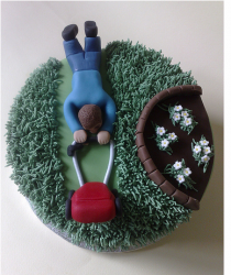 Fathers day gardening cake with cake topper of a father mowing.PNG