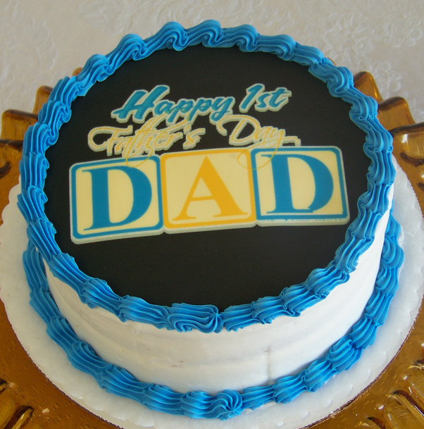 First father's day cake picture with blue and yellow cake decor and cake toppers.PNG