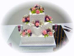 intersting wedding cake with colorful flowers