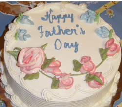 Round homemade fathers day cake with a traditional cake decor.PNG