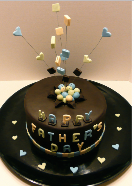 Trendy and chic fathers day cake with colorful cake decors.PNG