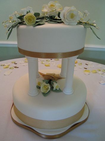 2 tier wedding cake with pillars two tier white wedding cake with columns and white 10185
