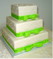 Square Quinceanera Cake for wedding with bright green ribbons.PNG