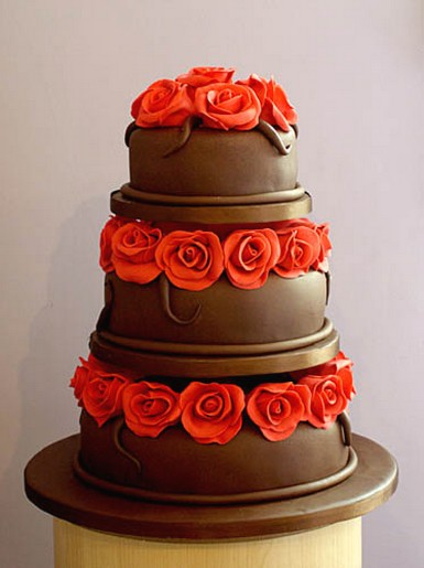 chocolate wedding cakes with red roses chocolate wedding cake with roses in three tiers 12804