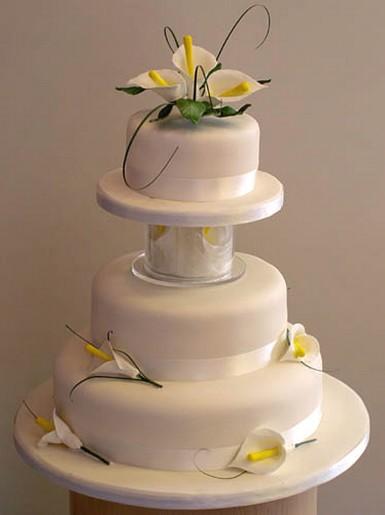 Beautiful wedding cake in white with yellow flowers mightylinksfo