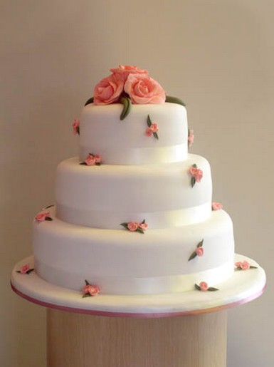 pretty wedding cake with peach roses