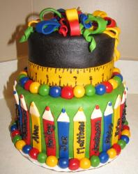 Two tier grade school theme cake with crayons and tape measure.JPG