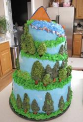 3 tier topsy turvy forest and hill camping theme cake.JPG