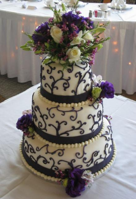 round wedding cakes with purple flowers three tier wedding cake with purple flowers and 19338
