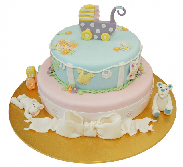 Two tier Baby Shower Cake with full of cake decorations.