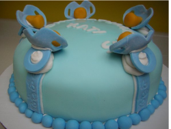 Very Creative Baby Boy Shower Cake in blue with very cute cake decoration.PNG