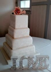 Light Pink 4 tier square wedding cake with pink rose on top.JPG
