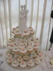 Romantic cupcakes for wedding  with bride and groom cake toppers