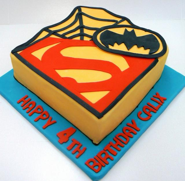 Superhero theme birthday cake with superman batman and spiderman symbols.JPG